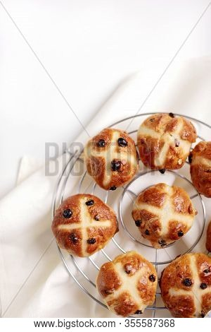 Buns Marked With A Cross And Containing Dried Fruit, Traditionally Eaten During Lent. Selective Focu