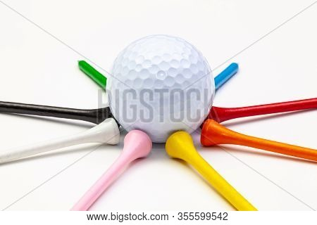 Golf Set - Ball With Tees. Golf Tees In The Rainbow Colors.  Star Composed Of Golf Ball And Wooden T