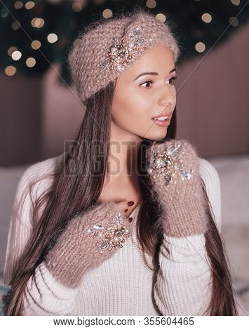 Portrait of beautiful young brunette woman with makeup in  beaded headpiece