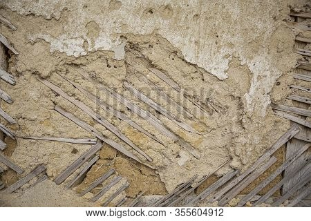 Close Up Of Cracked Adobe Wall Texture, Clay Wall From A Mud House.