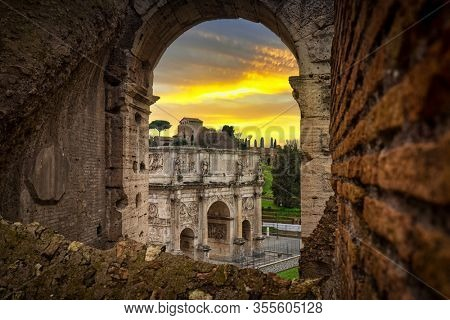 Arch of Constantine and the Colosseum at sunset, Rome. Italy