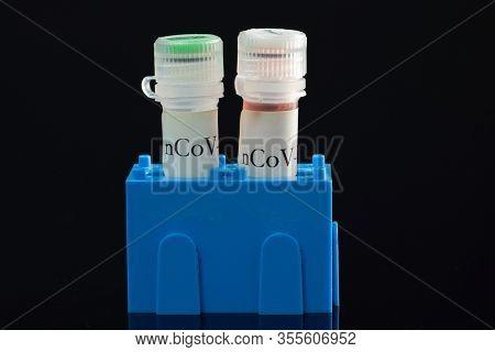 Coronavirus PCR Test Kits on black
