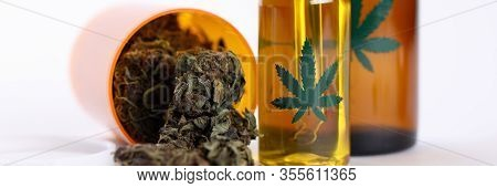 Close-up View Of Different Plastic Bottles With Cannabinoid Oils. Cannabis Extract For Cosmetology.