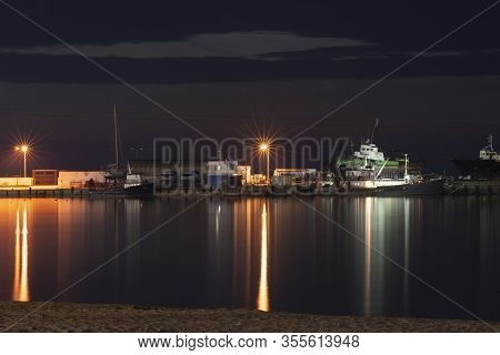 Anapa, Russia, 8 March 2020. Seaport With Boats On The Slipway In Anapa. Seaport With Light At Night