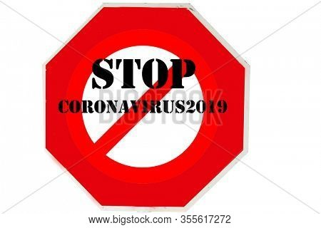 STOP SIGN. Stop Coronavirus19. Coronavirus Sign. Red USA Stop Sign with STOP CORONAVIRUS19 over International NO Symbol. Isolated on white. Clipping Path. Room for text or images.