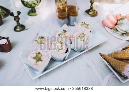 Top View Of Tasty Birthday Cupcakes Of Pink Pastel Color With Stars On Top, And Other Sweet Confecti