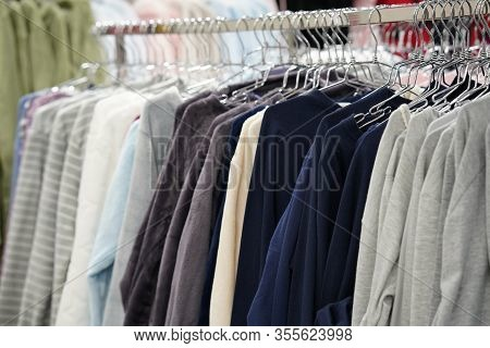 Fashionable Clothing On Hangers In Shop. Sport Of T Shirts Are Hanging On Clothes Hanger, T Shirt. C