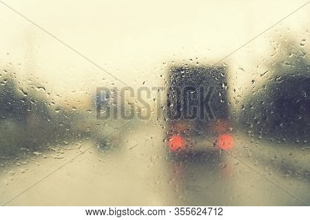 Dense Traffic On A Rainy Day. Traffic In Rainy Day With Road View Through Car Window With Rain Drops
