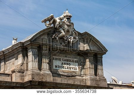 The Famous Puerta De Alcala On A Beautiful Sunny Day In Madrid City. Inscription On The Pediment: Re