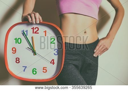 Fit Woman With Abs Holding Clock.weight Loss Concept.