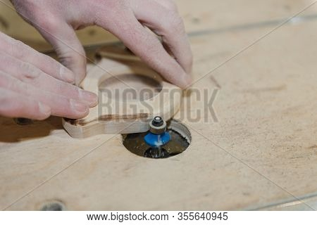 A Man Carves A Toy On The Machine. Making Wooden Toys. Toys Made Of Wood. Safe Toys. Educational Toy