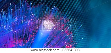 Fiber optics network cable on technology background