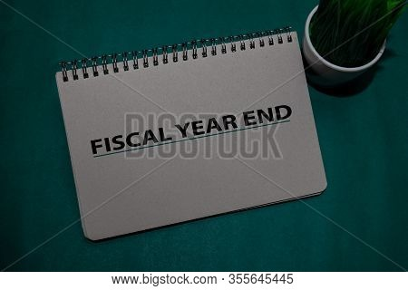 Fiscal Year End Write On A Book Isolated On Office Desk.