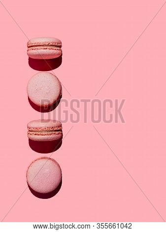 Pink Macarons With Copy Space. Row Of Perfect French Macarons Or Macaroons On Pink Background. Top V