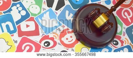 Wooden Judge Gavel Lies On Many Paper Logos Of Popular Social Networks And Internet Resources. Enter