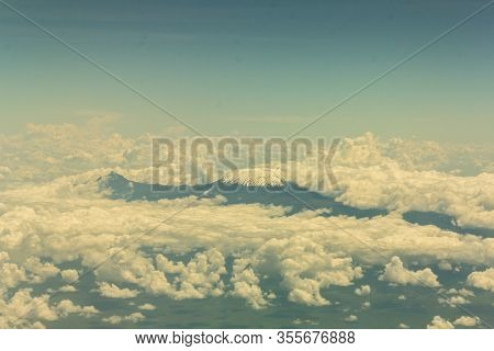 Mount Kilimanjaro Covered With Snow And Clouds