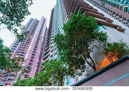 Hong Kong City High-rise Residential District In The Evening. Scenic Upward Landscape Of High Skyscr
