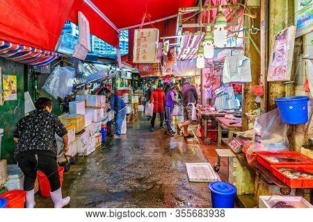 Hong Kong, China - January 18, 2016: Hong Kong Street Markets Abound With Fresh Meat And Fish. Eveni
