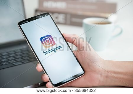 Chiang Mai, Thailand - Mar 08, 2020 : Female Hand Holding Oneplus 6 With Login Screen Of Instagram A