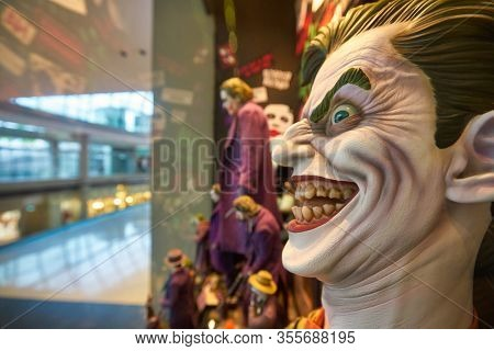 SINGAPORE - JANUARY 20, 2020: close up shot of Joker life size head sculpture on display in DC Comics Super Heroes Cafe at the Shoppes at Marina Bay Sands in Singapore.