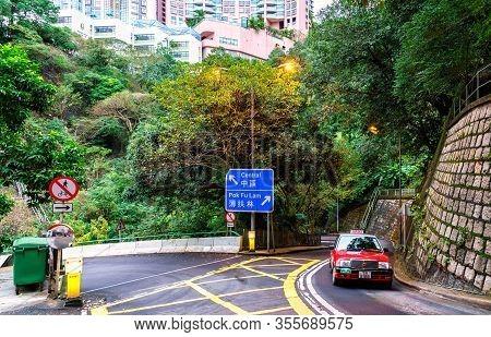 Hong Kong, China - January 29, 2016: Central And Pok Fu Lam Crossroad On Hong Kong Island. Hong Kong