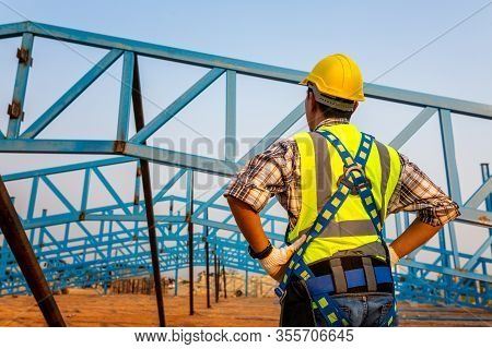 Working At Height Equipment In Construction Site. Fall Arrestor Device For Worker With Hooks For Saf