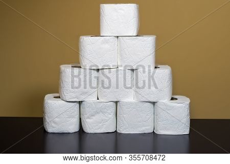 Toilet Paper Shortage Concept With Stacked Rolls. A Pile Of White Toilet Rolls To Illustrate The Iss