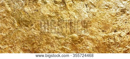 Texture Of Shiny Gold Leaf Beautiful. Gold That Has Been Smashed Into Thin Sheets Is Used To Close T