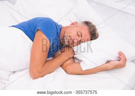 Sleeping Guy At Home. Relaxed Man. Promote Prevention And Management Of Sleep Disorders. World Sleep