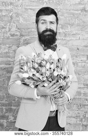 How To Be Gentleman. Guide For Modern Man. Romantic Man With Flowers. Romantic Gift. Macho Getting R