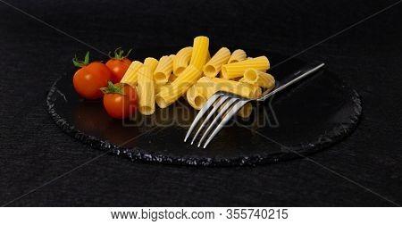italian rigatoni and tomato slate food pasta