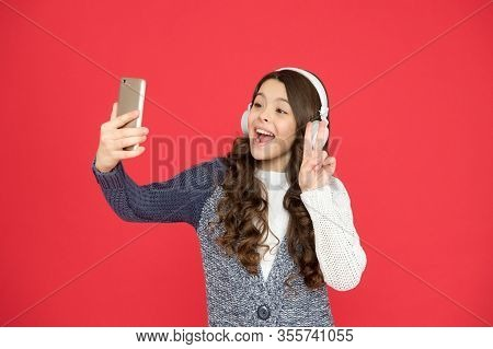 Cheerful Girl Video Calling With Friends. Happy Child Sing Song Red Background. New Technology. Hey
