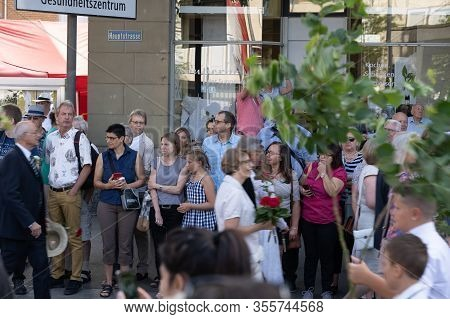 Main Street With Spectators Who Are Watching The Parade Of School Children At Rutenzug Brugg On The