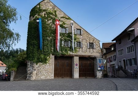 Storchenturm Of Brugg With Flags Of Switzerland, Aargau And Brugg. Historic Building Decorated At Ju