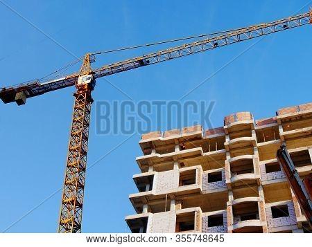 Construction Site. Building Site With Crane. Concrete Building Under Construction. Industrial Backgr