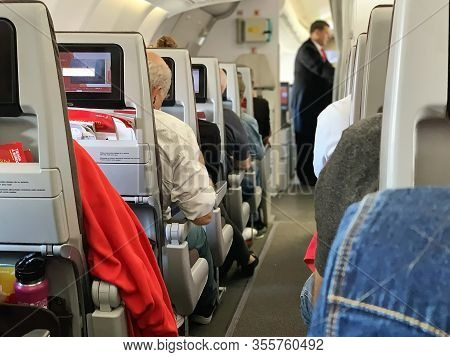 Madrid, Spain - May 16, 2019: Iberia Aircraft Interior. Airplane Interior - People Sitting On Seats