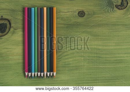 Image Of Multi Colored Crayons On Wooden Table.