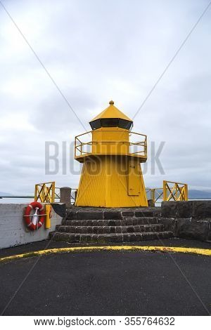 Image Of Yellow Lighthouse On Harbor In Reykjavik,icleand.