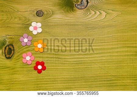 Image Of Multi Colored Petals Wooden Table.