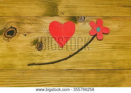 Image Of Flower With Heart Shape On Wooden Table.