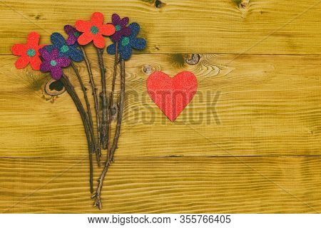 Image Of Bouquet Of Flowers With Heart Shape On Wooden Table.