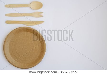 Eco- Friendly Tableware For Food And Wooden Eco-knife, Fork, Spoon On A Light Background With A Copy