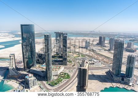 Aerial High Shot Of Al Reem Island Sun And Sky Towers, Gate Towers And Other Landmarks In Abu Dhabi