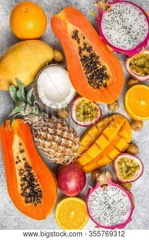 Set Of Exotic Tropical Fruits On Light Gray Background - Papaya, Mango, Pineapple, Dragon Fruit, Ora