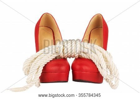 Red High Heels And Rope Isolated On White Background. Bondage Concept.