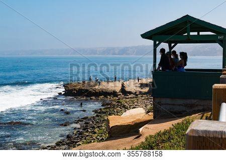 La Jolla, California - June 16, 2017:  People Take In Views Of The Ocean In The Boomer Beach Area Of