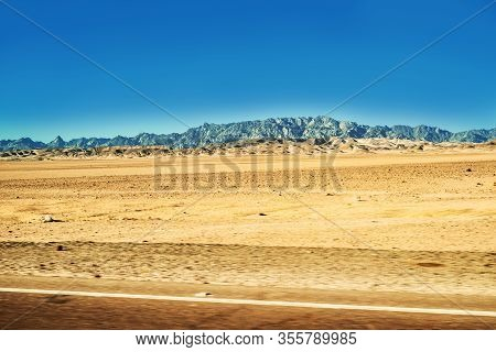 Safari In Egypt Sinai, Travel Of Tourists In The Sahara Desert.road In The Desert. Yellow Sand And B