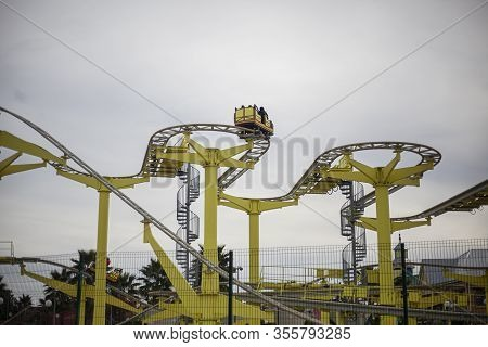 A Roller Coaster In An Amusement Park. Relax In Fun Amusement. Fun For The Townspeople. Rail-type Me