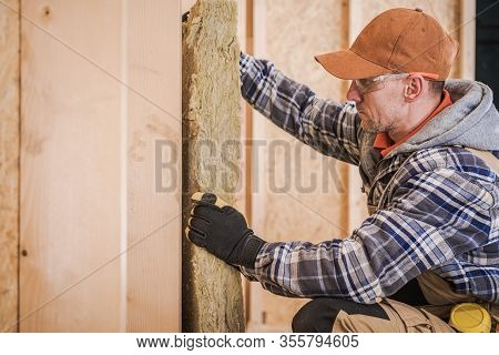 Mineral Wool Insulation Layer. Construction Worker Building Interior House Wall Filling Space With I