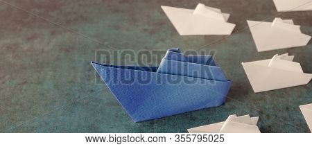 Origami Paper Ship With Small Sailboats, Leadership, Marketing Concept, Social Media Influencers, Hr